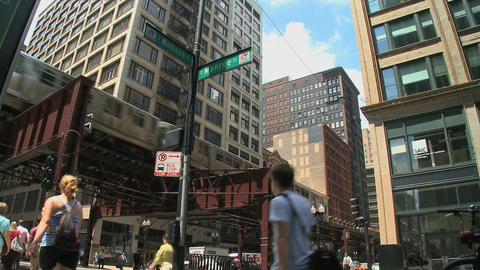 Pedestrians walk beneath Chicago's L (2 of 3) Footage