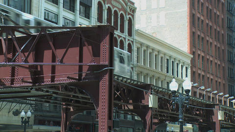 Elevated trains cross paths in Chicago Footage