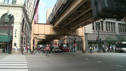 Traffic passes beneath Chicago's L (2 of 2) Footage