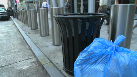 Garbage bag on city street Live Action