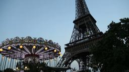 Tilt up on carousel near the Eiffel Footage