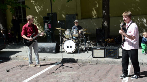 students play guitar drums in street. hard rock Footage