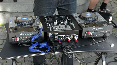dj hand mix dance music with mixer outdoor Footage