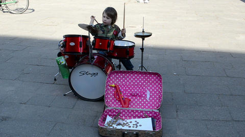young kid child play drums street music day. people audience Footage