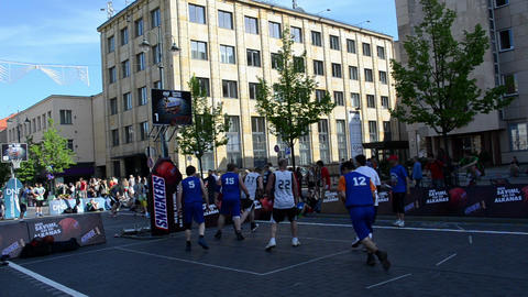 players play basketball in outdoor snickers tournament 3x3 Footage