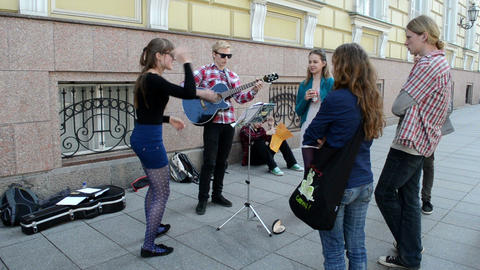 young teenagers play guitar dance street music free day event Footage