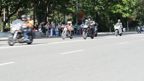 bikers ride motorcycles in birzai and people watch Footage