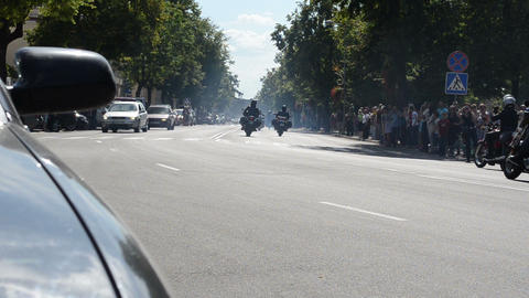 bikers people ride motorcycles pass street Footage