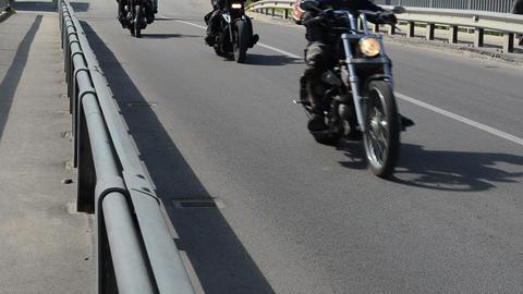 bikers ride motorcycles bridge road yearly biker festival Footage
