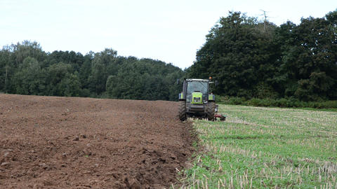 agriculture machinery tractor plow field forest Footage