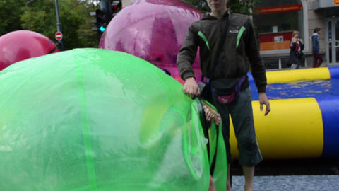 girl get out from zorb bubble ball in vilnius gediminas prospect Footage