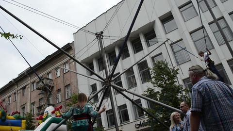 kids girl boy jump with safety belt on trampoline in playground Footage