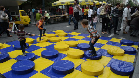 huge colorful checker game figures and kids walk play Footage