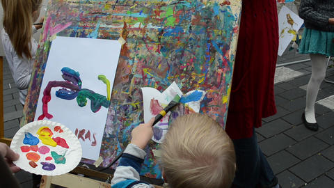 kids draw paintings brush outdoor street event Footage