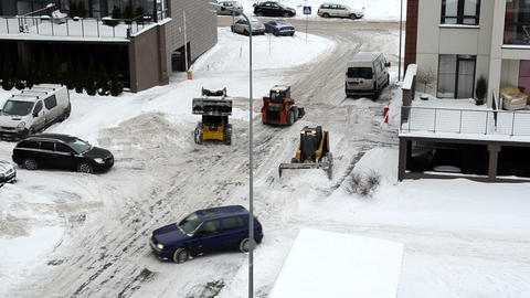 cars pass tractor clean flat house parking lot winter snow Footage