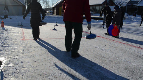 people play winter game curling eisstock frozen lake ice Trakai Footage