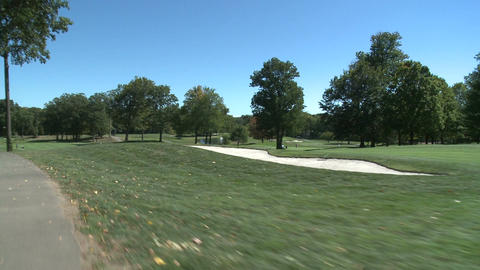 View of golf course while riding in cart (2 of 3) Footage