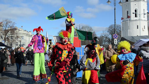 circus performers clowns with flags show city festival parade Footage