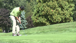 Golfer putts ball (2 of 2) Footage