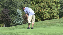 Lefty golfer putts ball (2 of 2) Footage