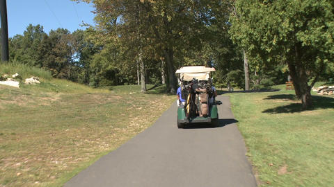 Following golf carts along path (1 of 4) Footage