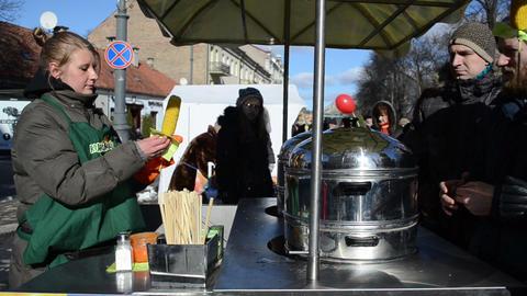 girl sells roasted corn spring festival market Footage