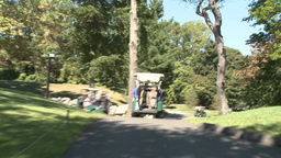 Following golf carts along path (4 of 4) Footage