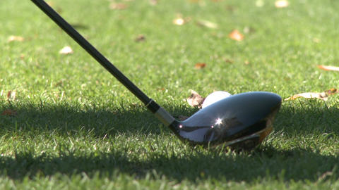 Close up of head of driver hitting ball off tee (1 of 2) Stock Video Footage