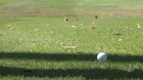 Close up of head of driver hitting ball off tee (2 of 2) Stock Video Footage