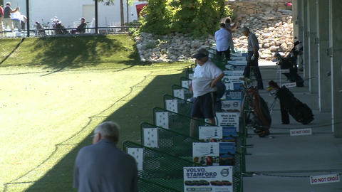 Golfers practicing at driving range (1 of 6) Stock Video Footage