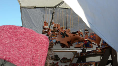 clay cow decorations hanging fair market tent people customer Footage
