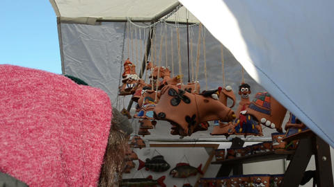 clay cow decorations hanging fair market tent people... Stock Video Footage