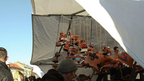 clay cow decorations hang fair market tent people customer Stock Video Footage