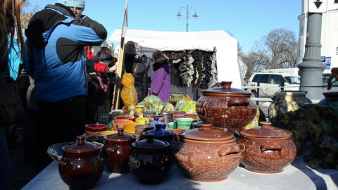 young woman sell handmade crockery clay pots crafts market fair Footage