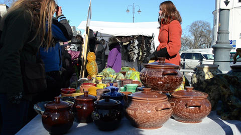 young woman sell handmade crockery clay pots crafts... Stock Video Footage