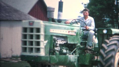 (8mm Vintage) 1962 Farmer Driving Tractor Family Iowa Farm Stock Video Footage