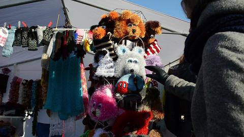 woman handmade woolen knit kid caps spring fair market event Stock Video Footage