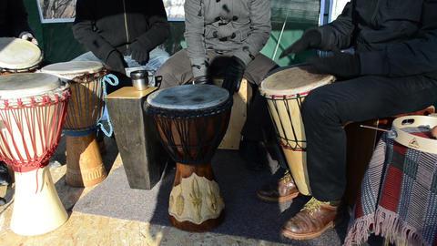 musician people play wood handmade drum outdoor spring concert Footage