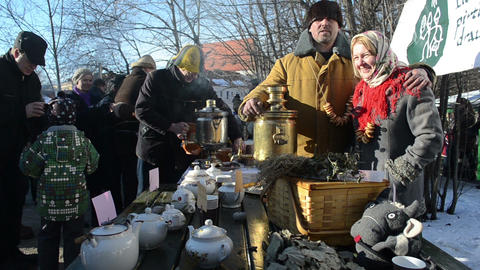 cheerful people make hot tea old retro tool spring event Footage