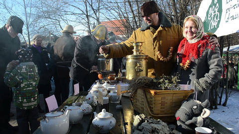 cheerful people make hot tea old retro tool spring event Stock Video Footage