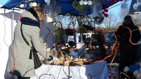 woman handmade angels decorations hang market fair tent Footage