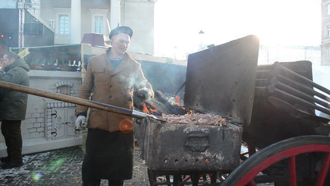 man bake meat chop firewood spring street fair fire smoke Stock Video Footage