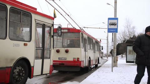 public transport trolley flags national holiday stop people snow Footage