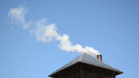 white smoke vapour rise house roof chimney blue sky Footage