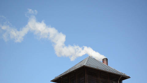 white smoke vapour rise house roof chimney blue sky Stock Video Footage
