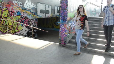 teenagers man woman walks stairs in city underground passage Stock Video Footage