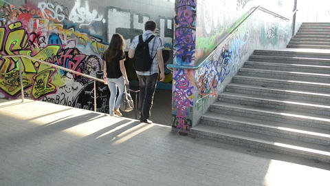 teenagers man woman walks stairs in city underground passage Footage