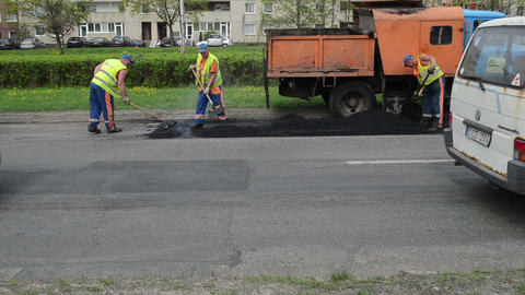 workers shovel put hot asphalt street road holes street... Stock Video Footage