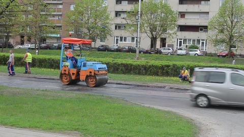 people work asphalt press vibration roller road repair Stock Video Footage
