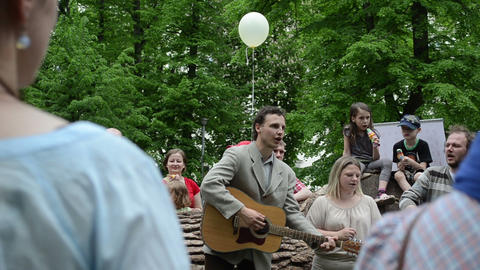 People play guitar and sing songs for kids in free city... Stock Video Footage